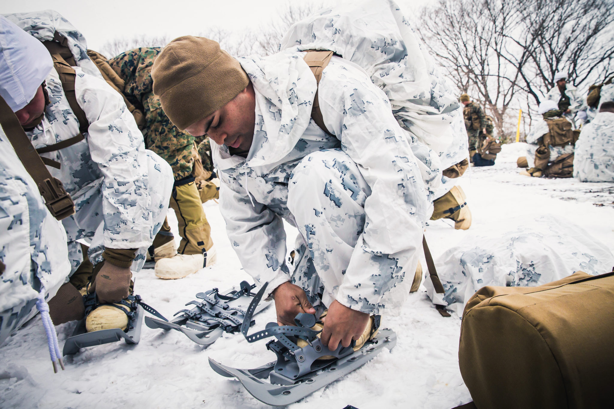 U.S. Marine Corps Lance Cpl. Brian Rubenacker adjusts his snow shoes during Exercise Forest Light on Camp Sendai, Sendai, Japan, Feb. 17, 2018. Marines conducted practical application using the extreme cold weather system. Rubenacker, a Farmdale, New York native, is a rifleman for Golf Company, 2nd Battalion, 1st Marine Regiment, 3rd Marine Division. (U.S. Marine Corps photo by Lance Cpl. Damion Hatch Jr.)