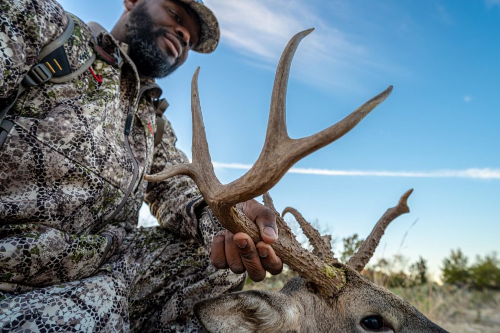 Warrior Denzel J. Washington with his buck on Cole Creek Ranch. Photo by Michael Herne/Coffee or Die.