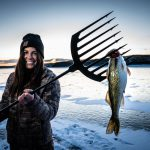 Laura Zerra with a walleye in South Dakota.